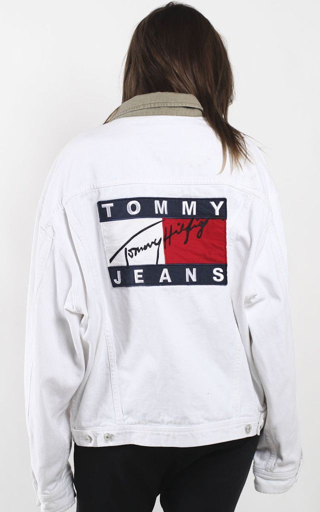 24bd0155ebfef Vintage Tommy Hilfiger white denim jacket featuring over sized logo on  back. Featured in the FRANKIE x HIGHSNOBIETY editorial MeasurementsSize on  tag  XLPit ...