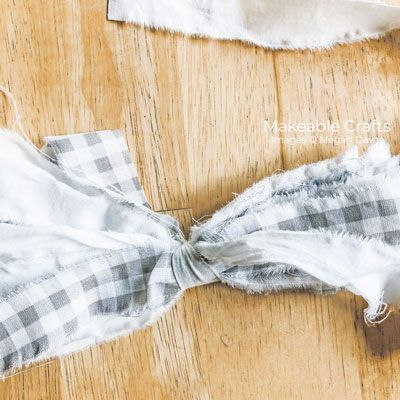 Make a simple rag bow using just fabric!  These rag bows are an easy way to add personality and life to any space in your home.  #simplehomedecor #ragbow