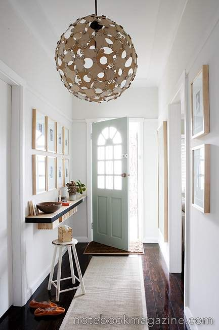 White foyer interior with circular ceiling lights and white doors ...