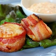 Bacon wrapped scallops with spicy cilantro mayonnaise.