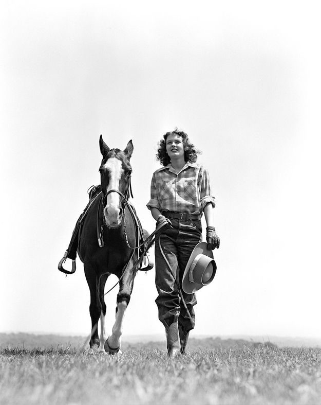 Woman's best friend in 1940. | 15 Retro Pics Of Truly Badass Cowgirls. Lots of emphasis on BADASS!