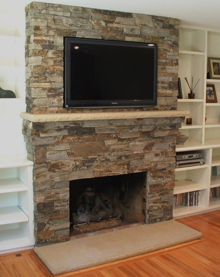 Tv above a stone mantle and shelving on the sides i 39 ve - Rockabilly mantel ...