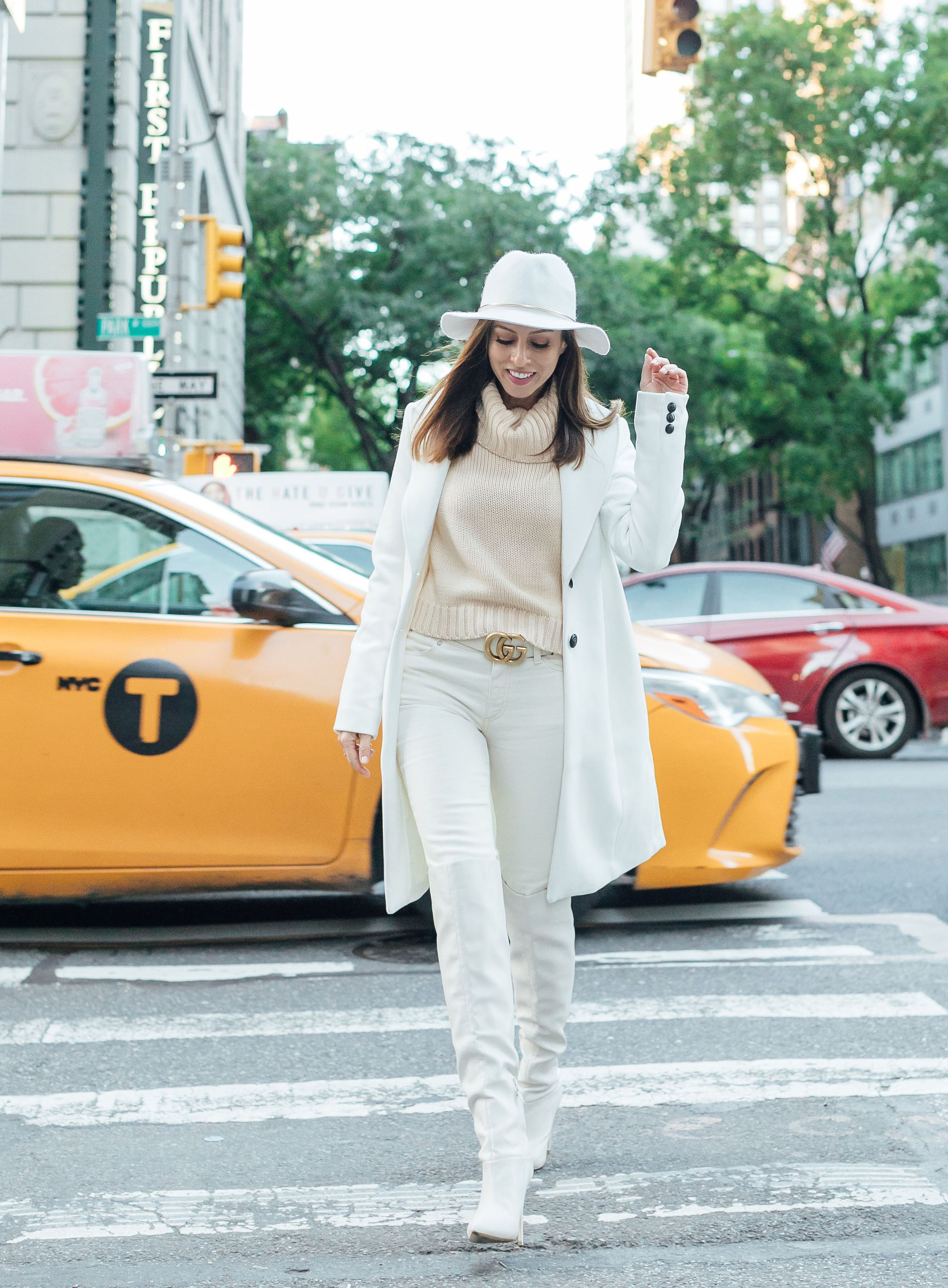 e393822d7102d3 Sydne Style shows how to wear winter white with white jeans in new york  city