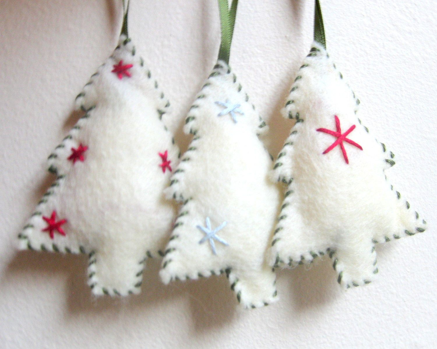 Felt ornament Christmas tree done in white with red trim to cute