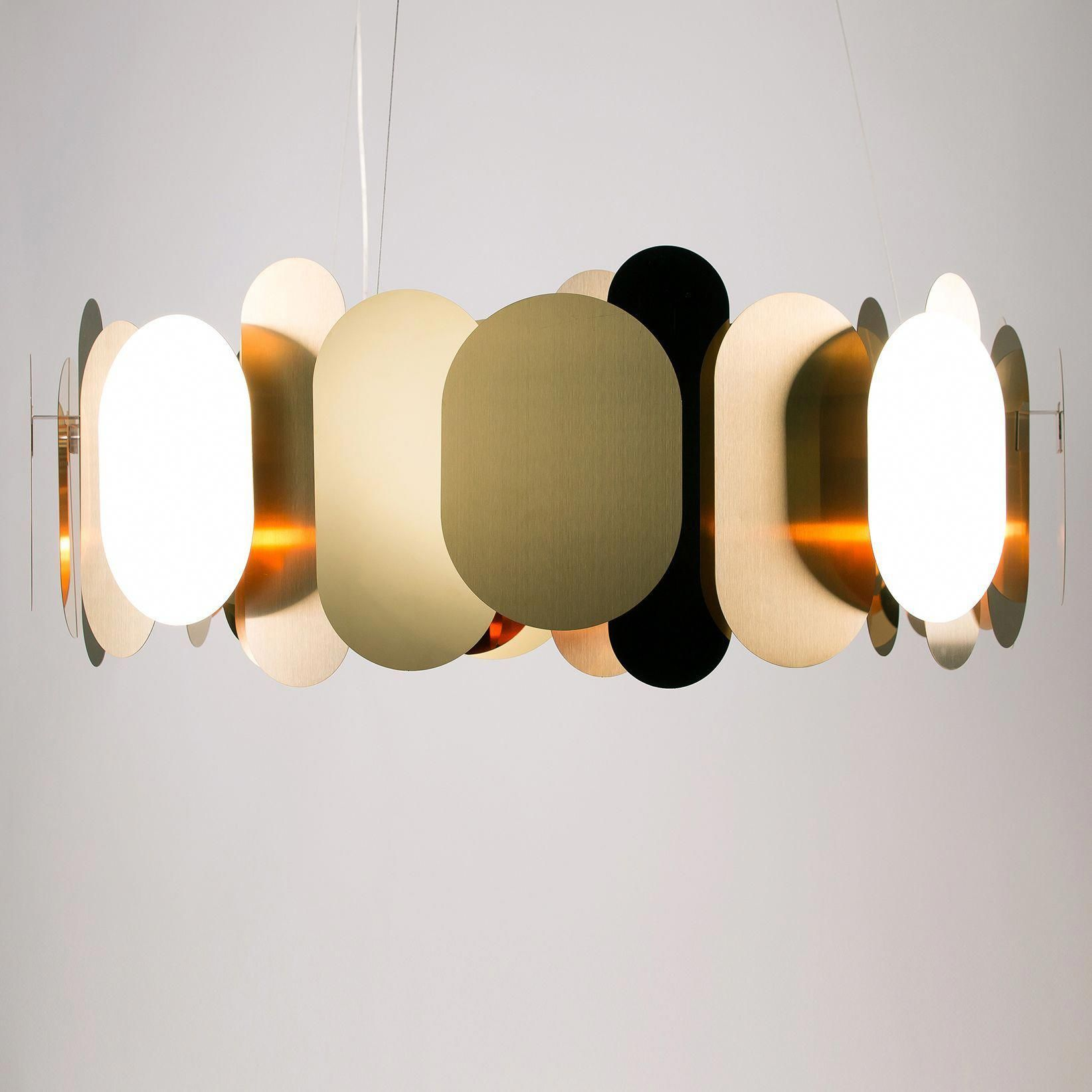 The Panel Pendant Uses Both Polished And Matte Surfaces To