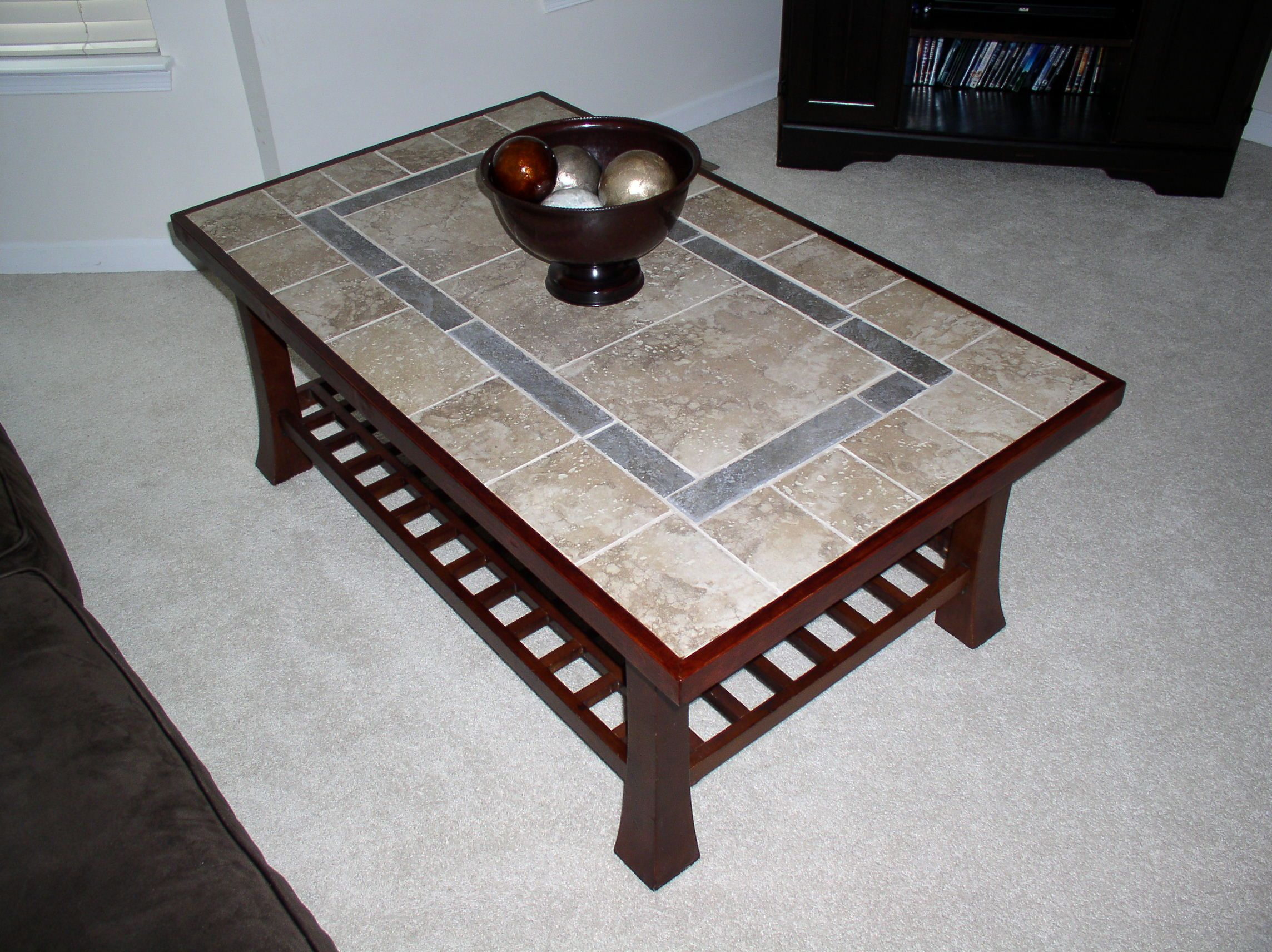 Refinished coffee table with a tile top and new wood moulding