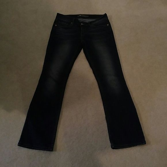 Levi 524 Bootcut jeans Size 7. Dark slightly distressed wash. Stretch. In great condition. Super comfortable! Levi's Jeans Boot Cut