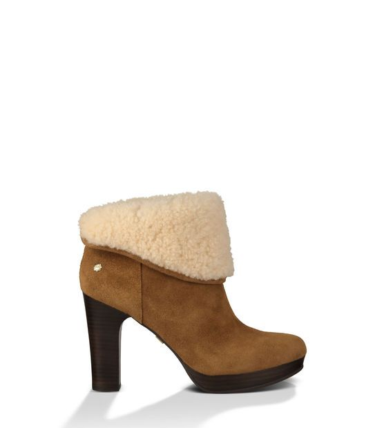 Details A Stacked Leather Wrapped Heel And Cuffable Shaft