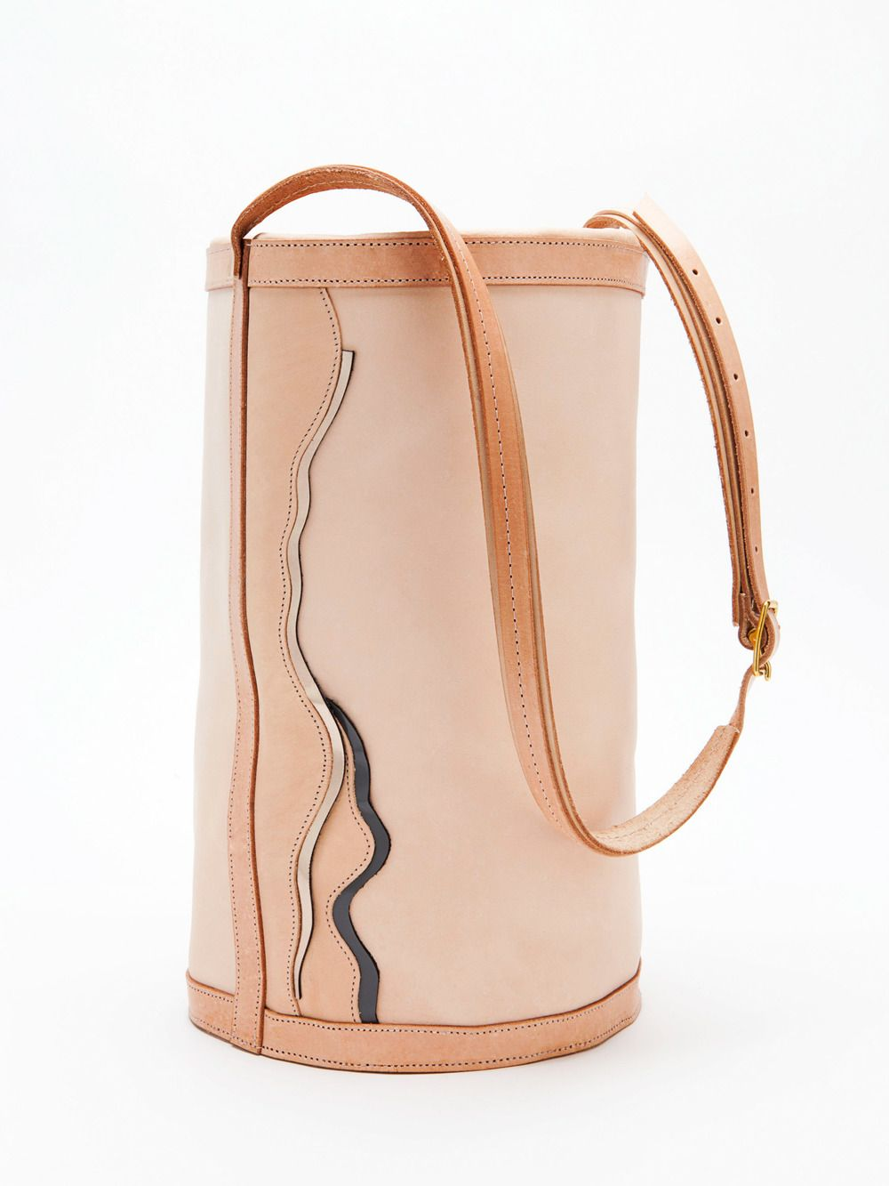 Limited Edition Bucket bag with pewter patent and slate grey colored waves  side detailing, draw-string leather top closure and adjustable long handle.  Solid brass hardware. Leather is a slightly rigid natural veggie-tan  leather that will maintain shape will giving out slightly at the base.