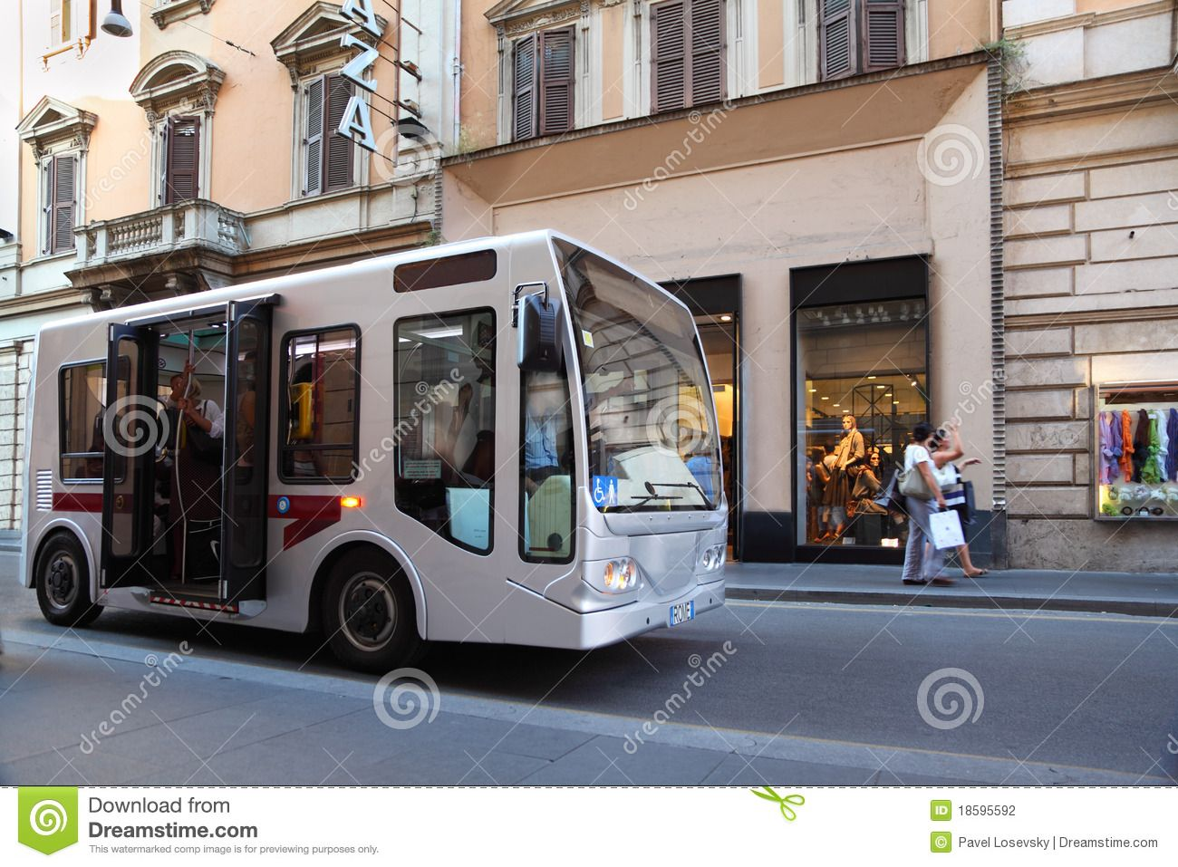 Small bus goes on streets of Rome, Italy