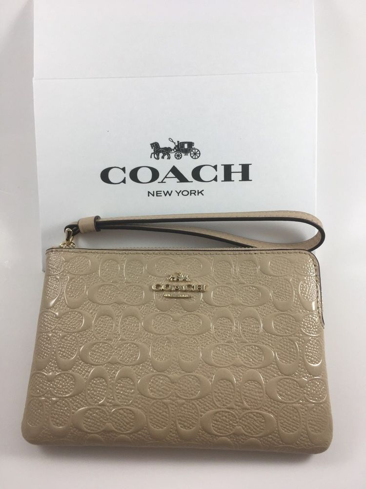 b1b0202eb61ed NWT COACH F58034 CORNER ZIP WRISTLET IN SIGNATURE DEBOSSED PATENT LEATHER   Coach  Wristlet