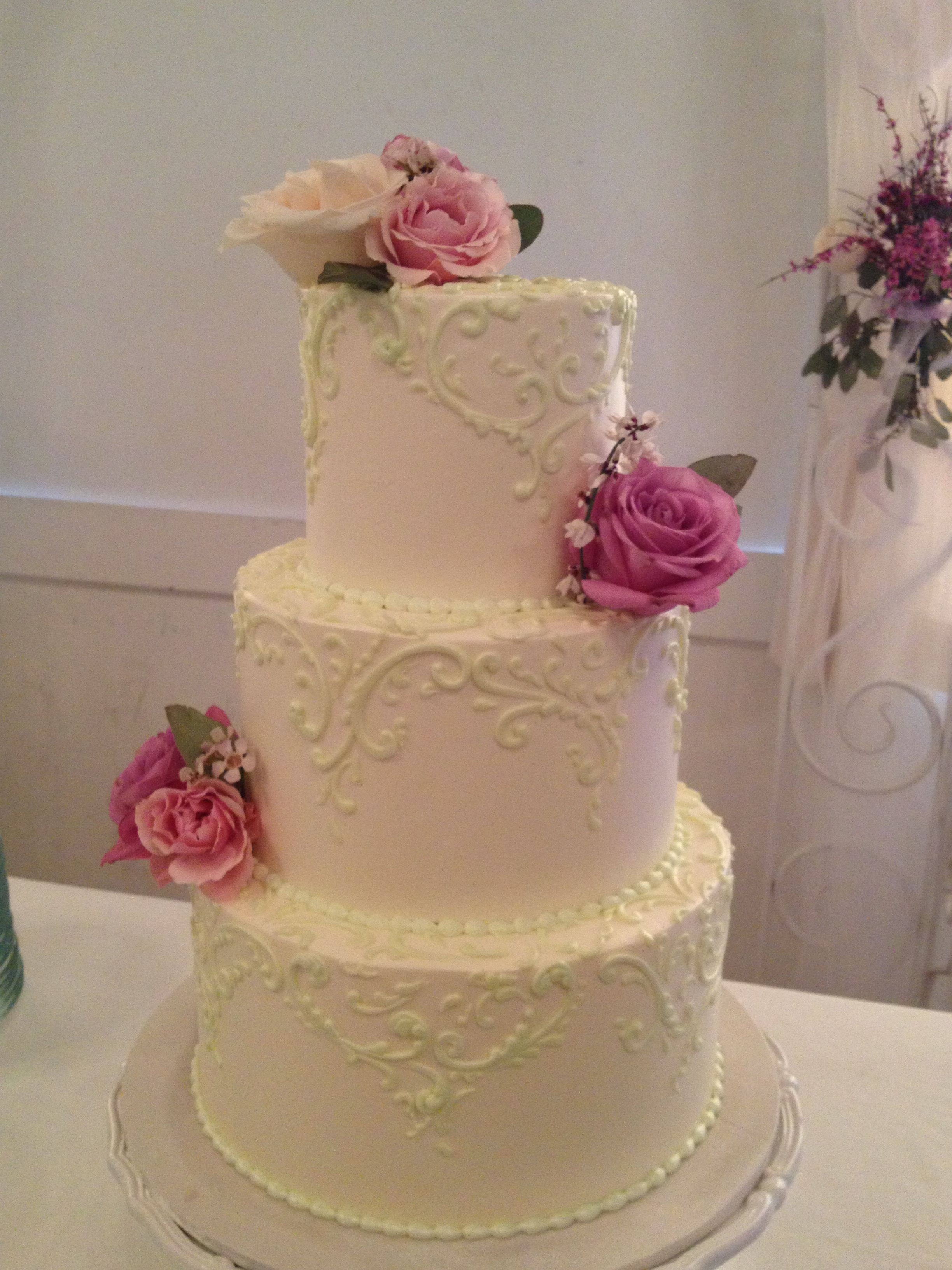 Tiered halfway scrolling with roses wedding cake package options
