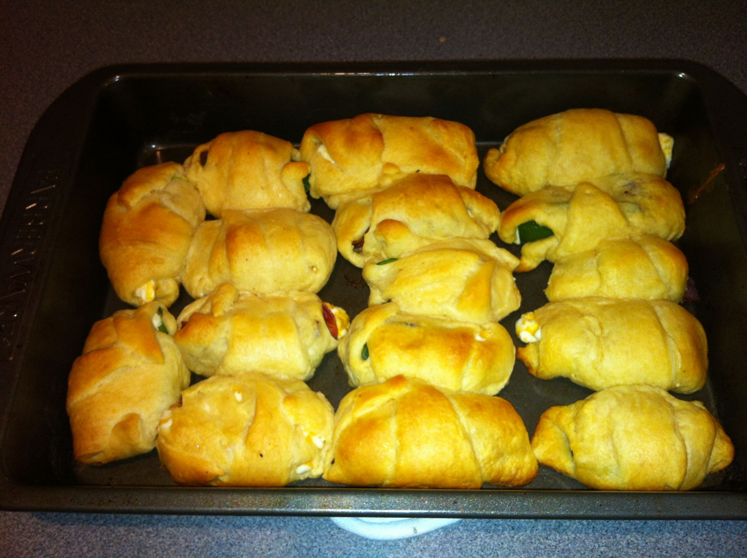 Baked Jalepeno Poppers Wrapped In Crescent Rolls Cream Cheese, Cheddar  Cheese, Jalepenos Sliced
