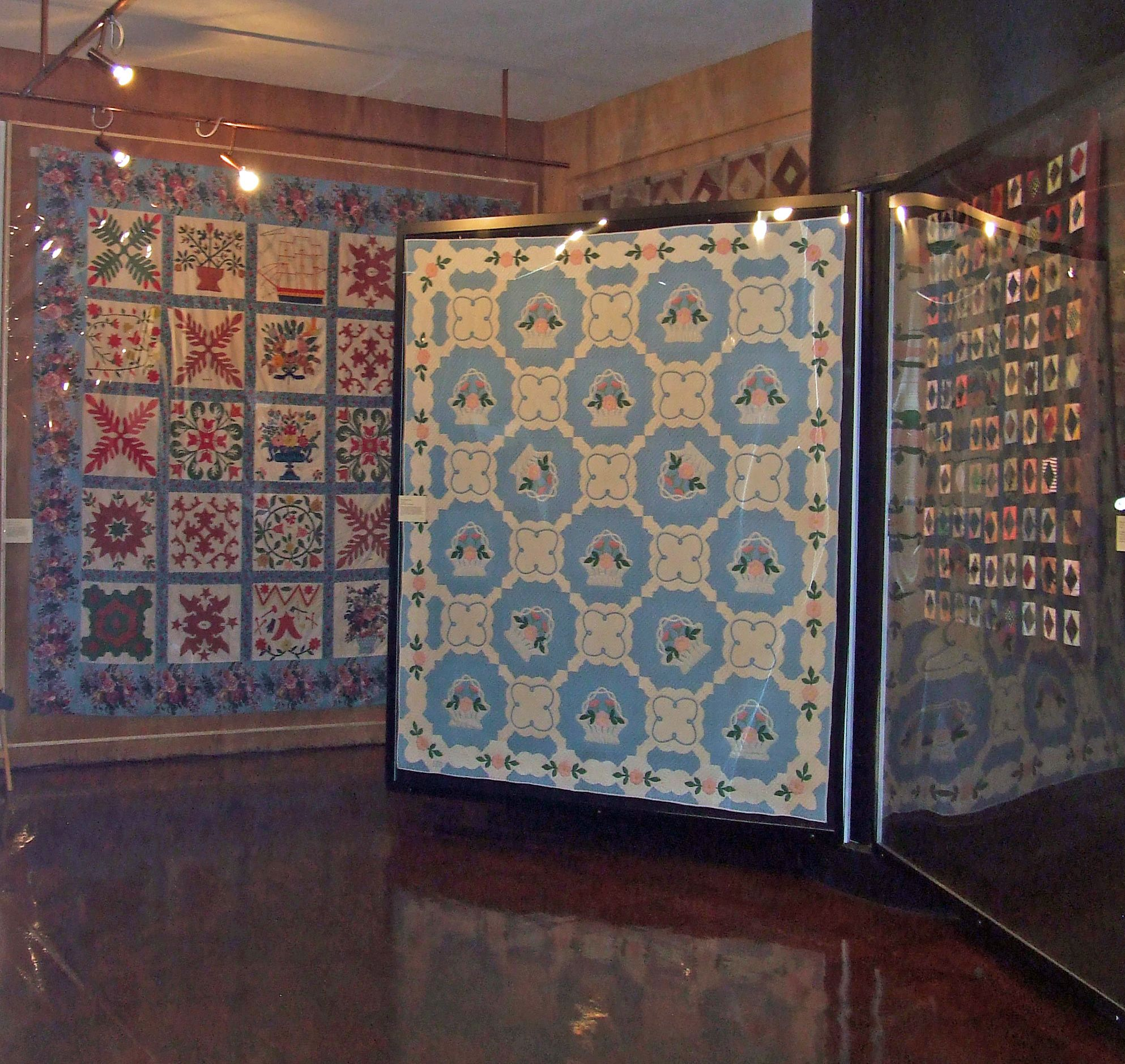 Baltimore album quilt (on wall) in the textile room American Museum, Bath UK