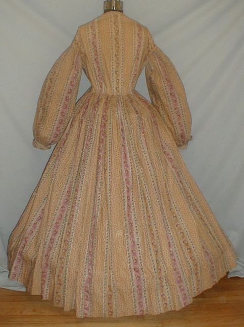 Fetching 1860's Tan Mauve Floral Print Cotton Dress | eBay I think this is actually a wrapper.