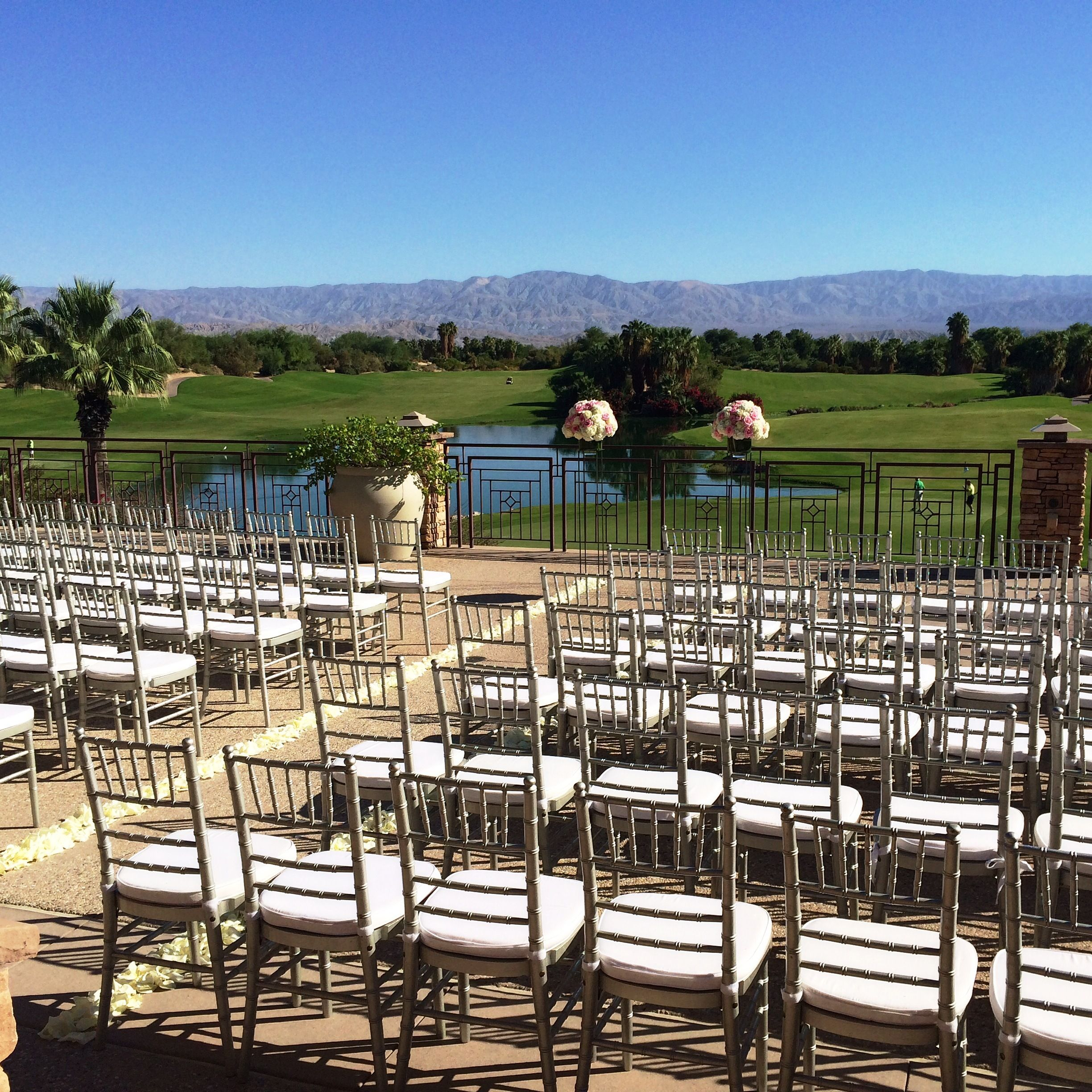 Golf course view wedding ceremony with silver chiavari chairs #PalmSpringsWeddings