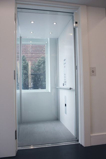 Savaria Eclipse elevator with glass cab is perfect for windowed hoistway and views of city