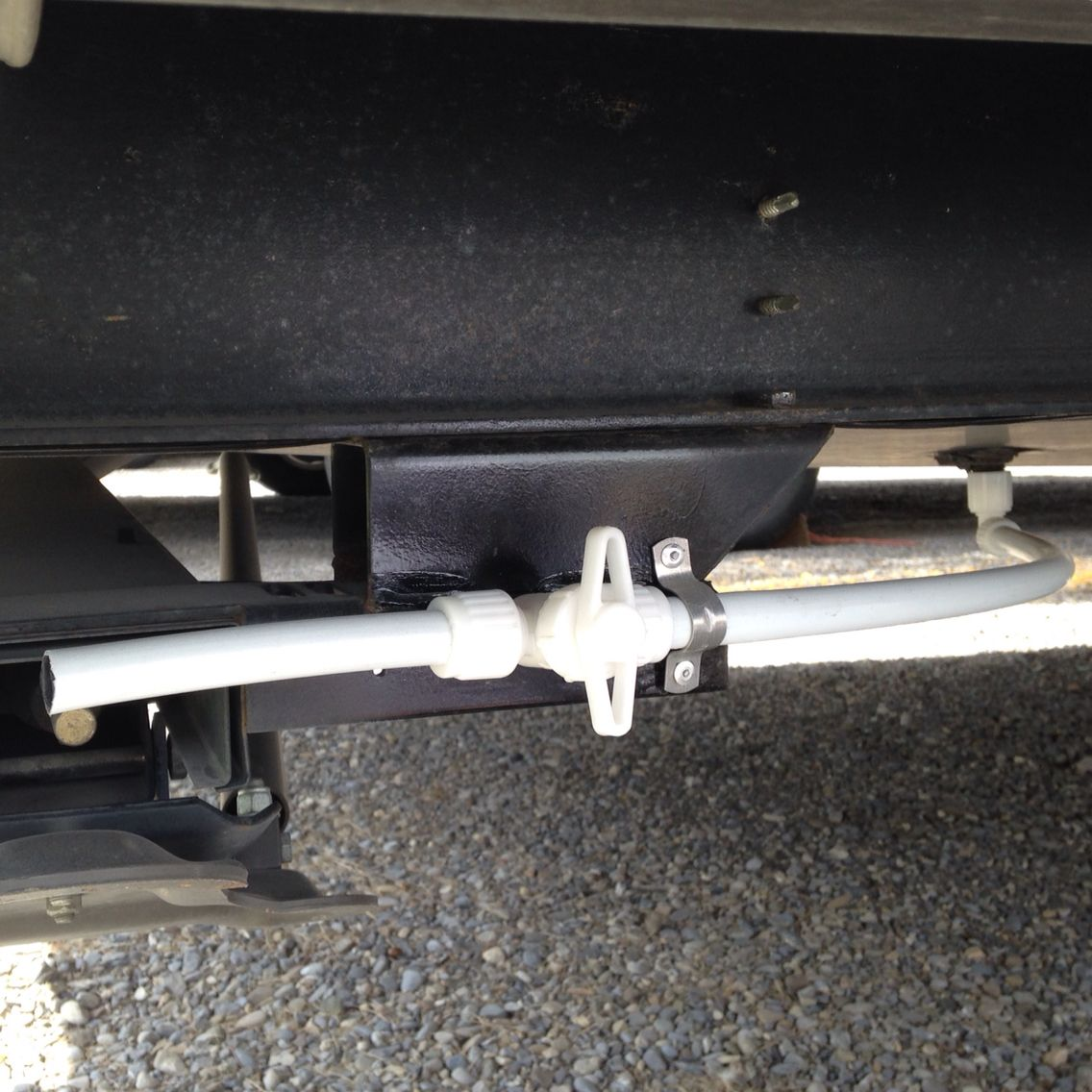 Tired Of Crawling Under Your Rv To Unscrew The Water Tank Plug Make Draining Your Fresh Water Tank Easier By Instal Camper Water Tank Rv Water Tank Water Tank