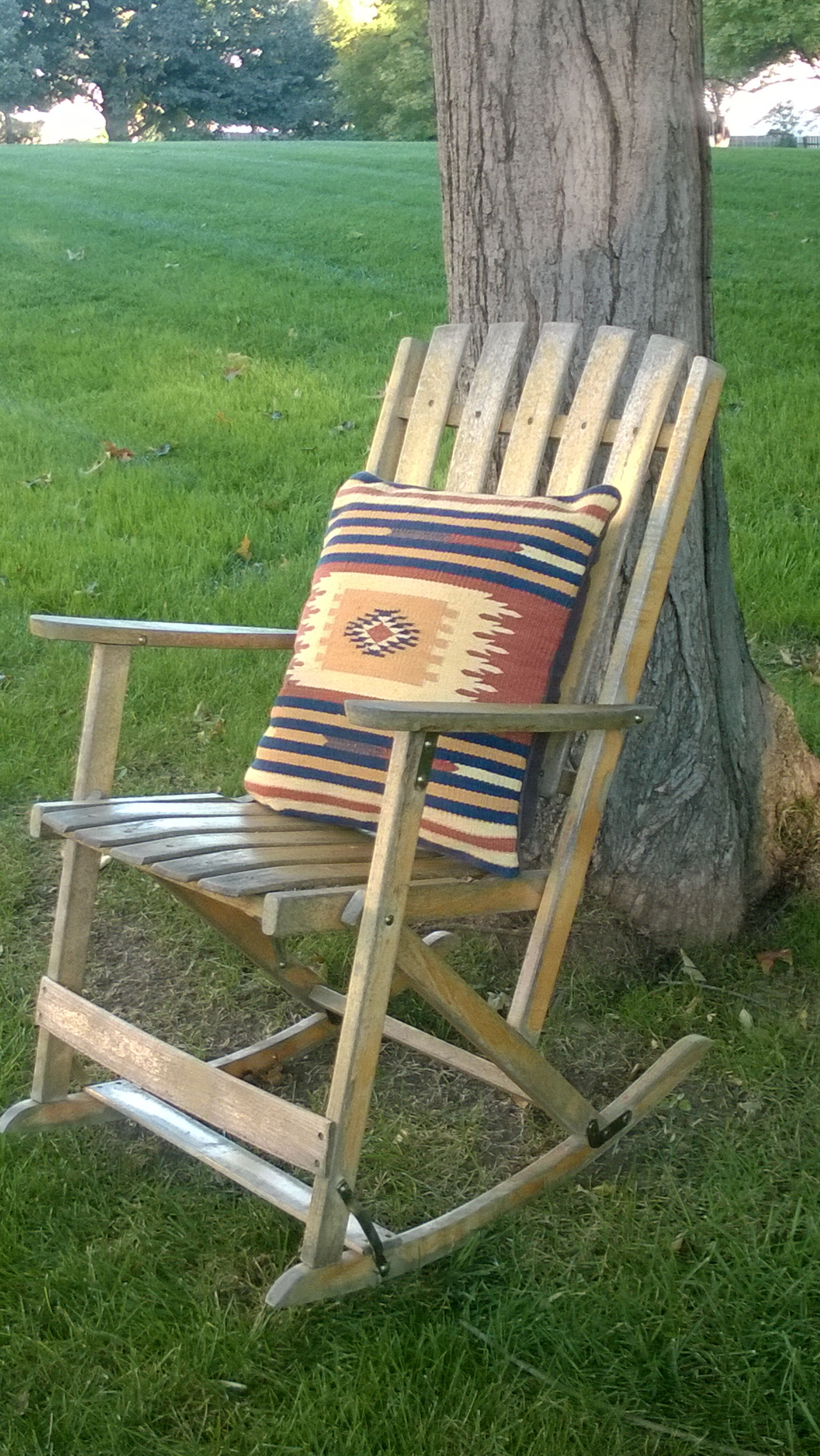 45 Vintage, weathered wood foldup rocking chair...(it