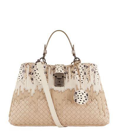 the Milano bag from Bottega Veneta is presented in the brand s signature  intrecciato weave with asymmetric ddb467291a723