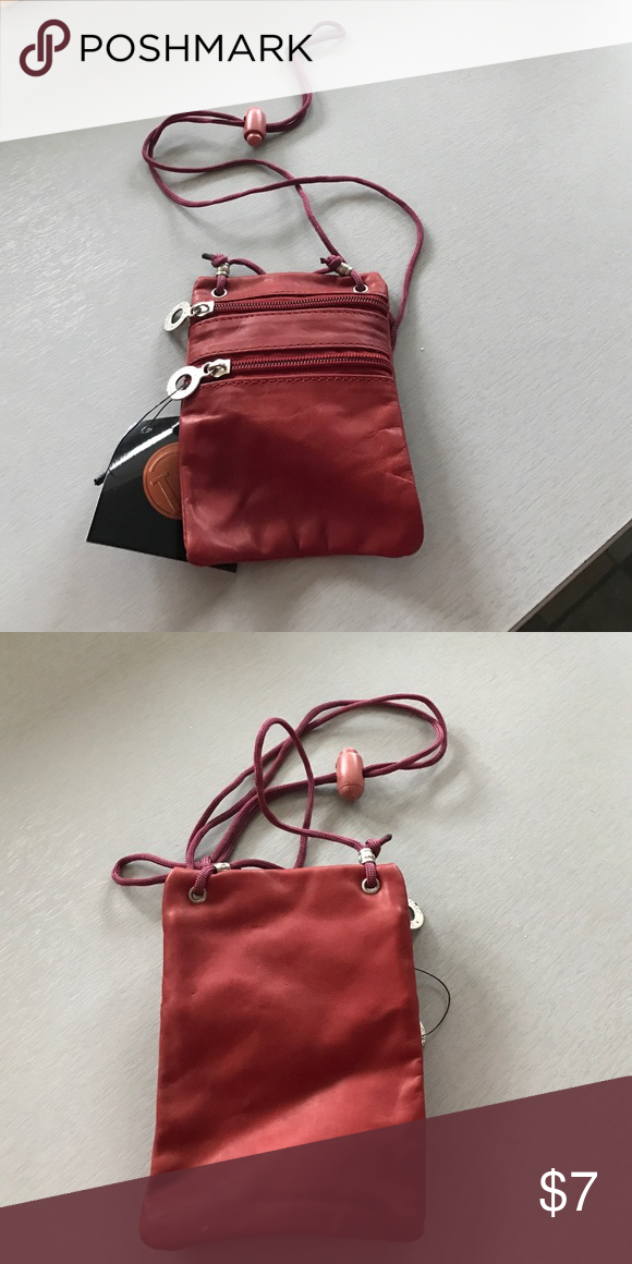 MINI LEATHER POUCH Adorable dark red mini LEATHER pouch. Has 2 zipper compartments. Perfect for coins, a few dollar bills, ID or credit cards and keys. Adjustable 24 in hang cord. Perfect to take with you to the gym, beach or on a walk or run! BRAND NEW with tag! Bags Mini Bags