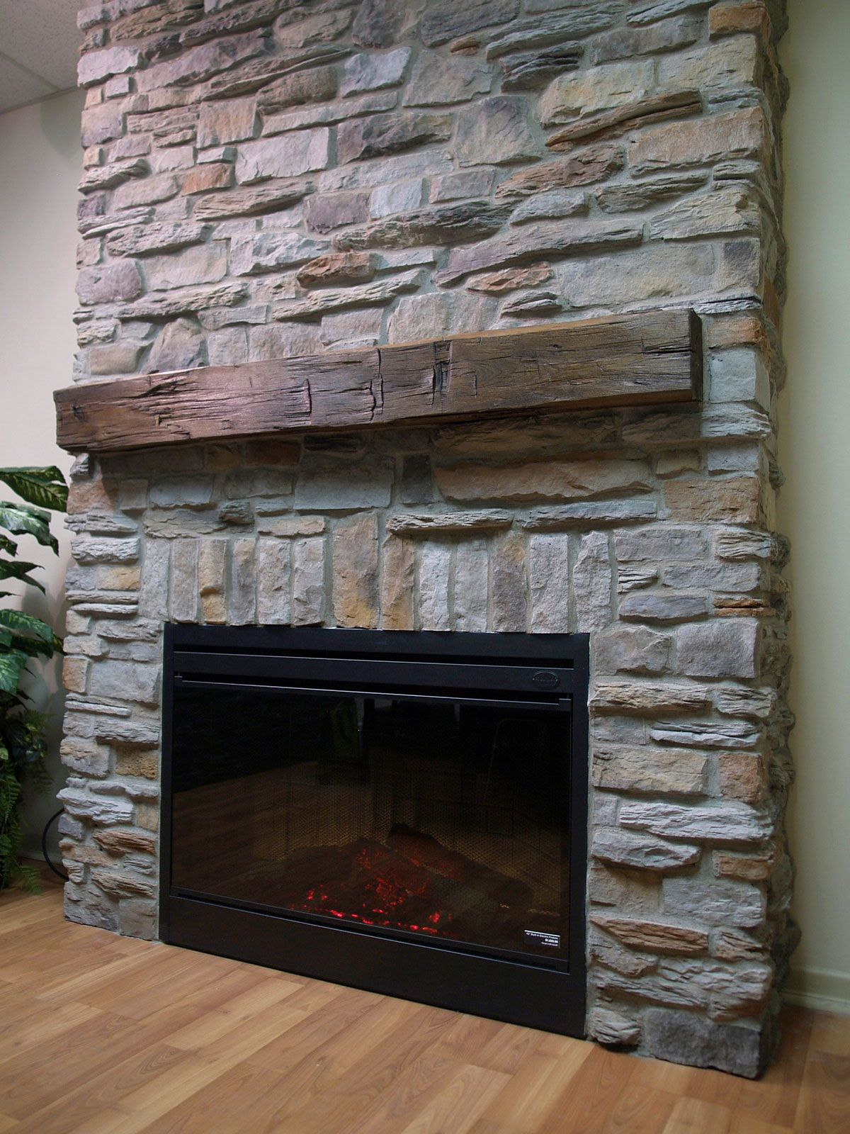 Faux fireplace with a stone wall for inside the lodge can - Stone fireplace surround ideas ...