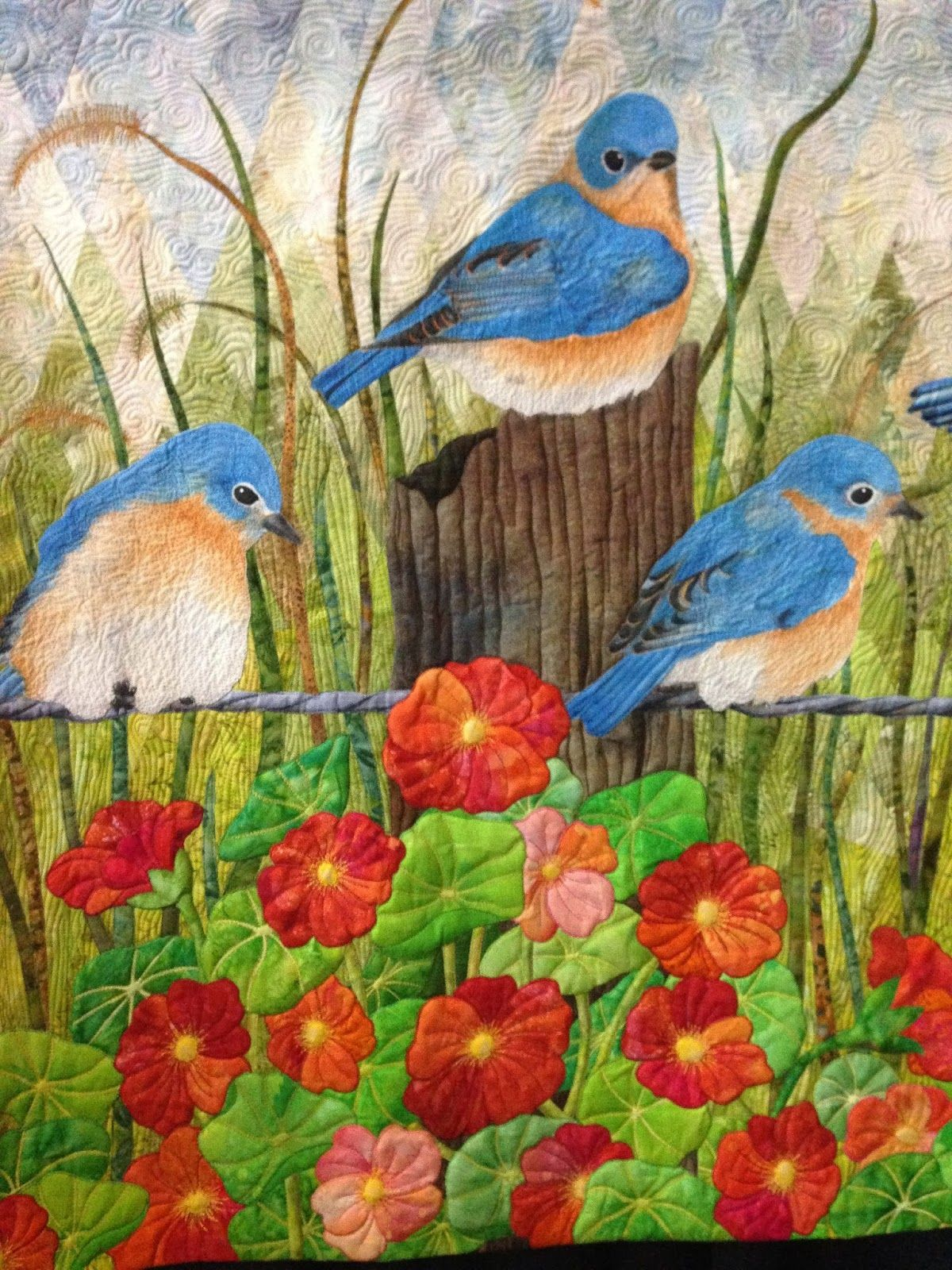 """Bluebirds"" by Laura Ruiz of Malabar, FL.  Best Pictorial Quilt, 2014 World Quilt Show - Florida.  Closeup photo by Blooming in Chintz."