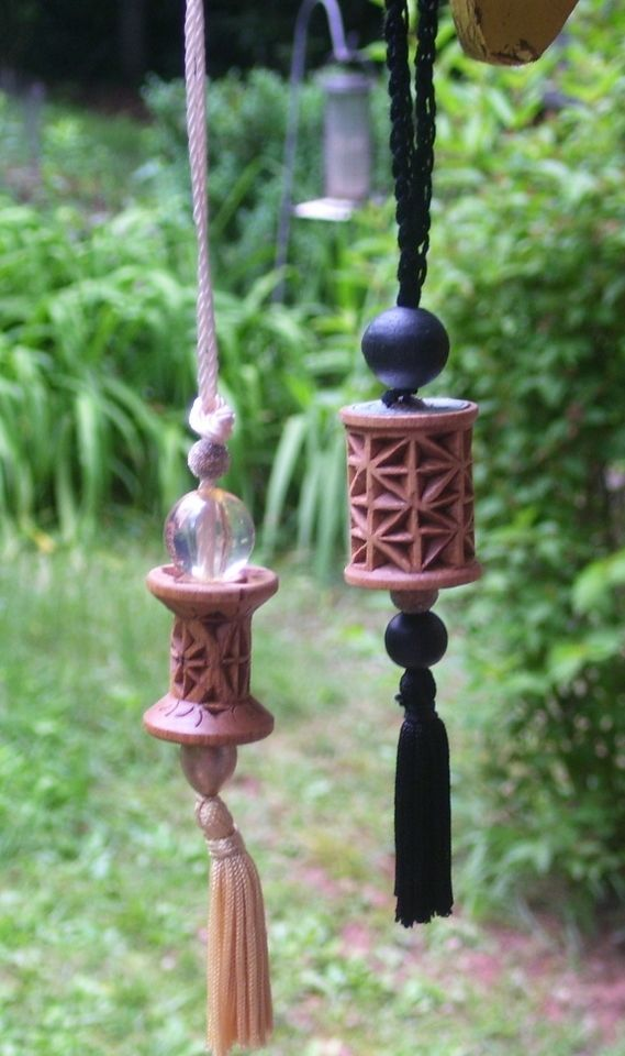 Chip carved empty spools of thread and made into necklaces