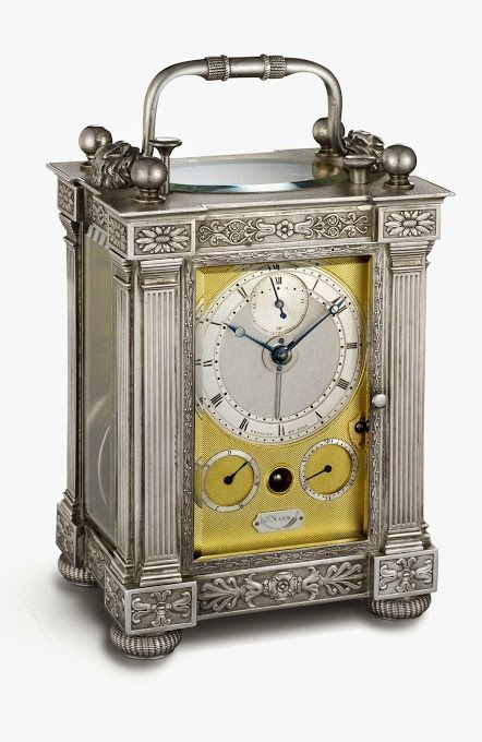 """Half-quarter-repeating travel clock."" With alarm; solid silver case, silver engine-turned dial, day and date indicator, platform lever escapement, compensating balance wheel; 4 3⁄8 × 3 3⁄8 × 2 1⁄2 in. (11.1 × 8.6 × 6.4 cm). Sold March 31, 1826, to Prince Serge Galitzin for 3,600 francs. B3358. Collection Montres Breguet S.A."