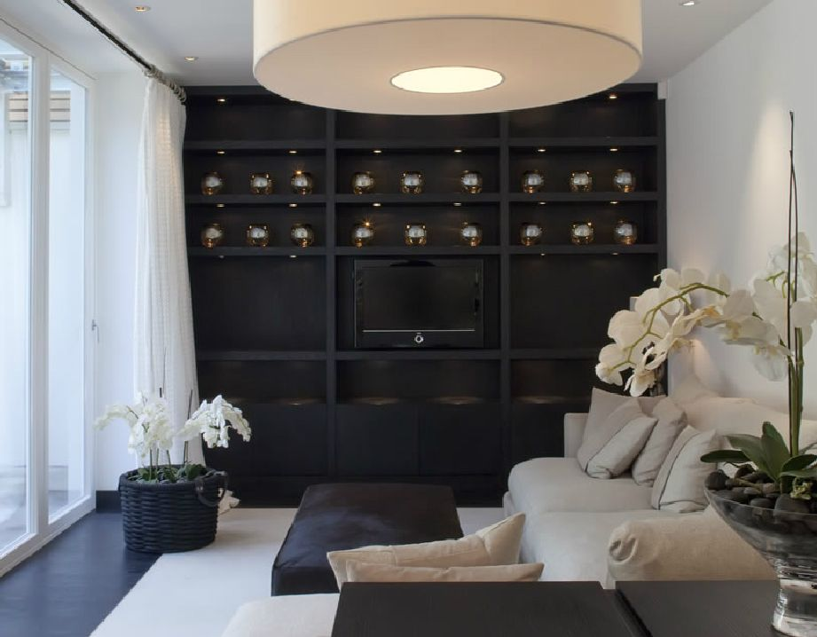 Black feature wall with black shelving kelly hoppen for Black feature wall living room