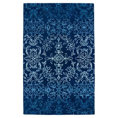 Anchor your living room seating group or define space in the den with this hand-tufted wool rug, showcasing a floral motif for eye-catching appeal.
