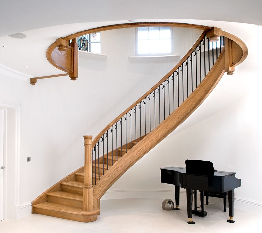 Wrought iron staircase – Wood-wrought iron/steel – Smet UK  Like the shape, don't like the wood color