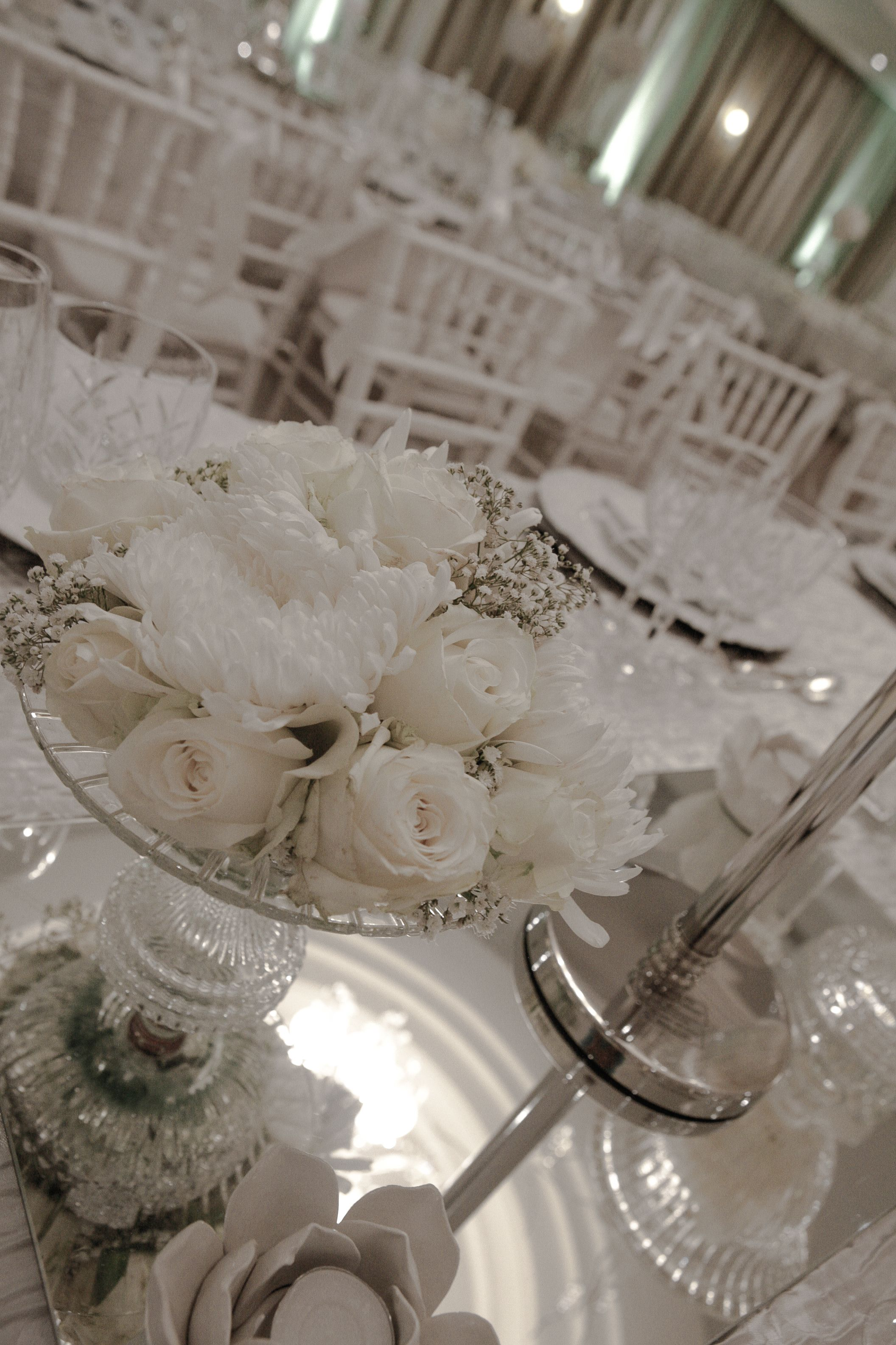 White Flower Arrangement In A Crystal Confetti Bowl Done By Sa