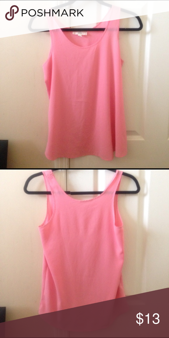 Light Pink Tank Top. 97% Polyester 3% Spandex Size S- But it fits me, so anywhere from XS-M would fit for you. Its very airy and loose fitting, great for layering with a jean jacket or something cute💕 Tops Tank Tops