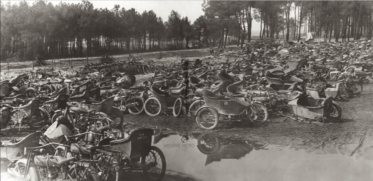 After the Treaty of Versailles was signed on June 28, 1919, the tens-of-thousands of American motorcycles, which had flooded onto the battlefields of Belgium, Germany, and France during WWI were collected for scrap or private sale. Countless mechanical boneyards like this one managed by the US Army Corps of Engineers in Le Mans, France were established to deal with countless damaged and surplus machines. Though it no comparison, the scene of so many abandoned and disabled machines heaped in…