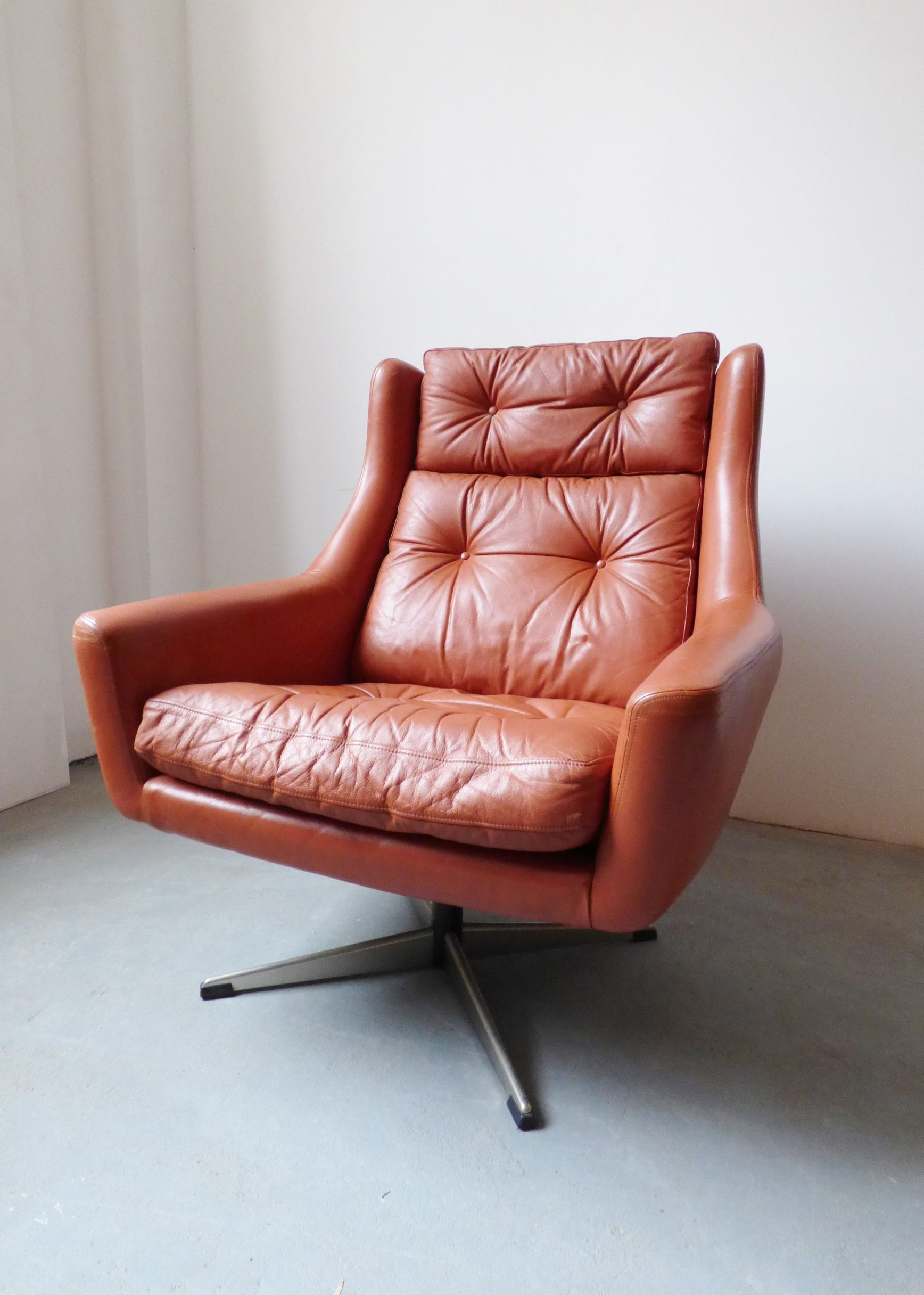 1960s Danish red leather swivel chair Leather swivel