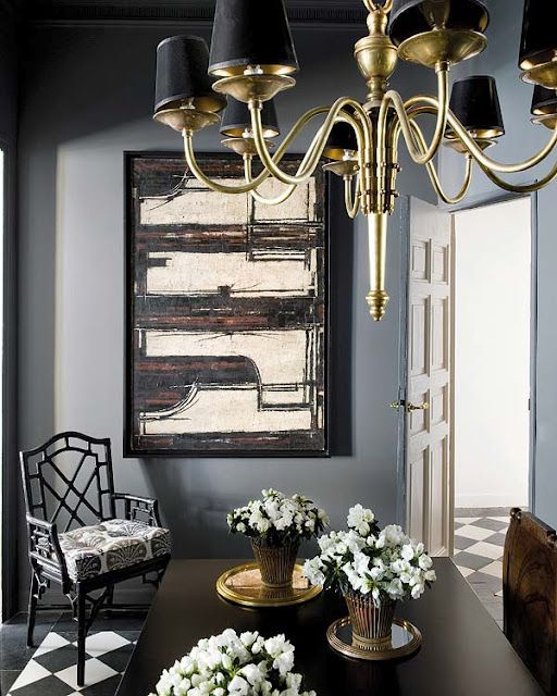 Blue and black dining room with blue walls  black abstract art  antique brass  chandelier with black shades  black faux bamboo chairs  black dining room  and. Suzie  Nuevo Estilo   Blue walls paint color  abstract art