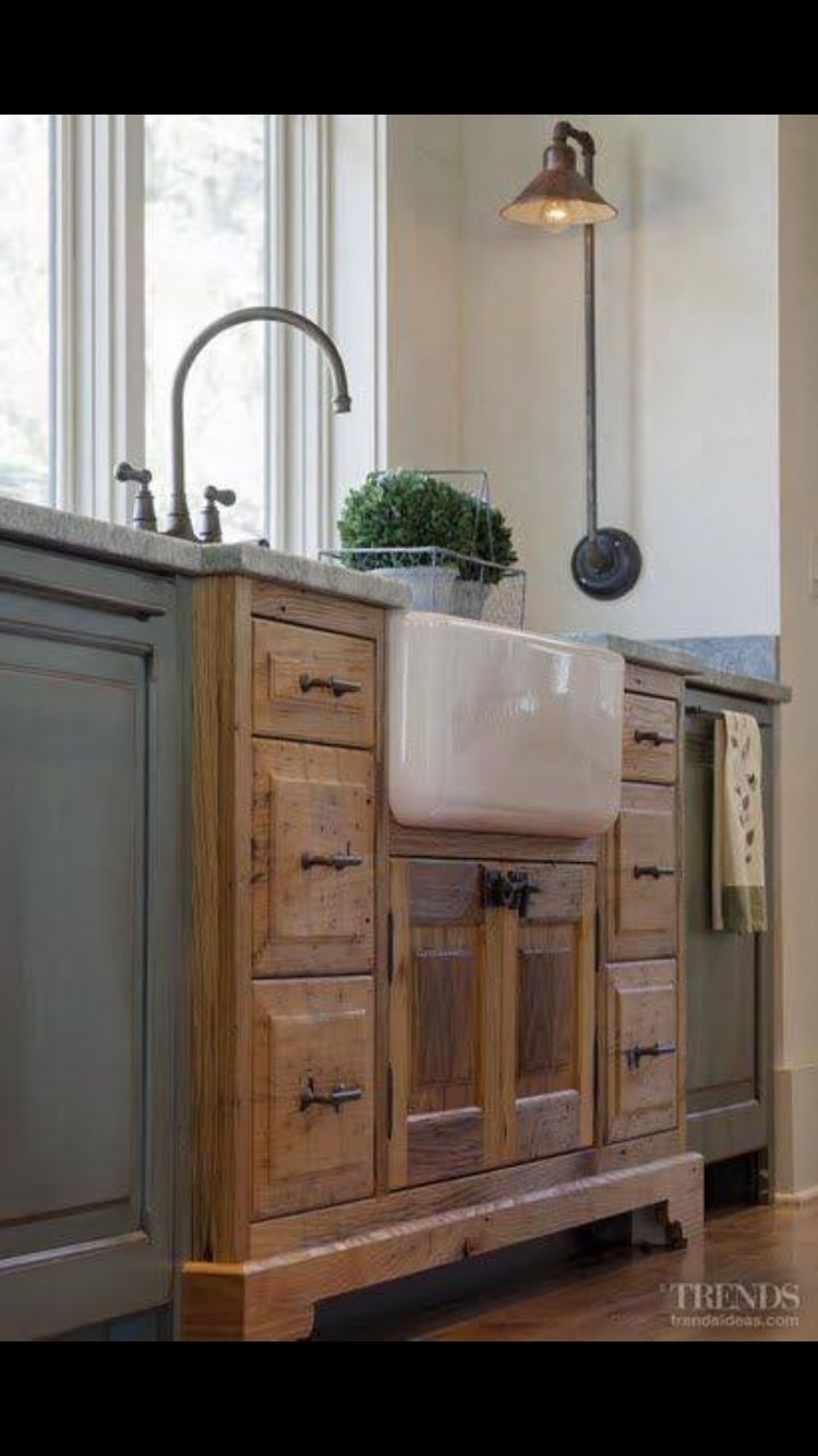 cabinets that look like furniture like how the sink looks like furniture built into the