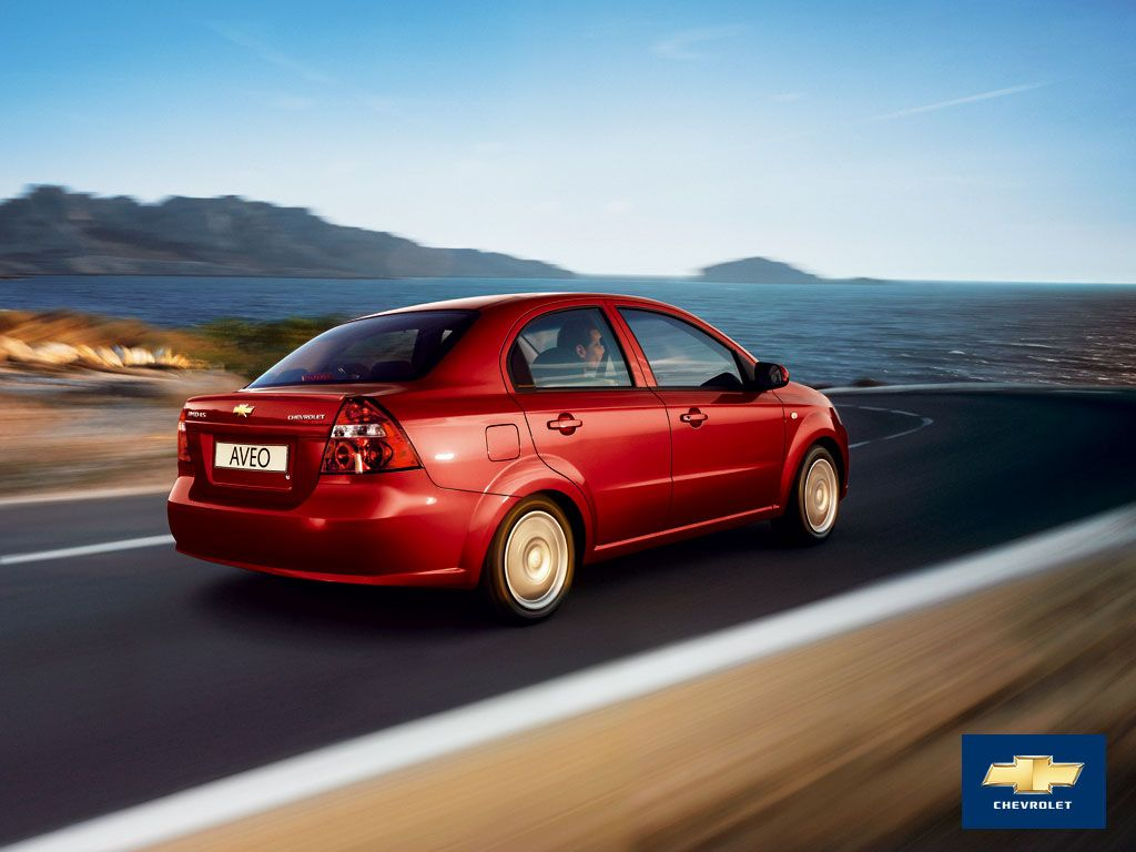 Red Chevrolet Aveo on the street - Car HD Wallpaper