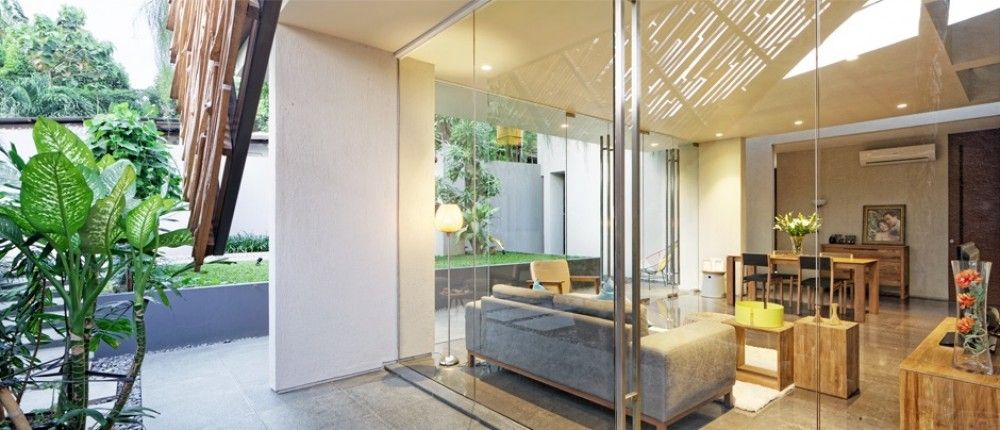 Living Area | DeeRoemah is a renovation project of a two-storey house on a 280 m2 irregular shaped site.