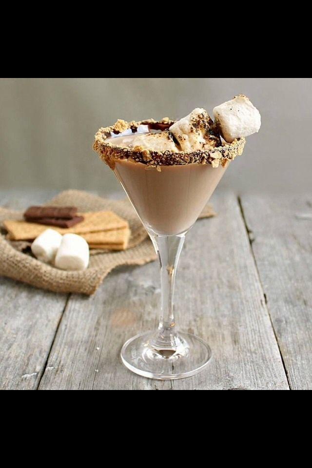 Chocolate S'more Martini!!   Gram cracker crumbs Chocolate syrup 1 part vanilla vodka 1 part chocolate vodka  1 part white chocolate liqueur 1 part white cream de cacao Marshmallows