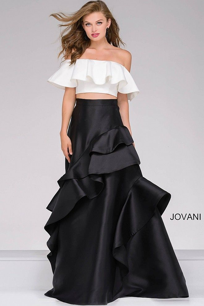 c8c01d3f8ba Elegant two piece floor length black and ivory dress features an off-the- shoulder ruffle detail top and an a-line skirt with a ruffle detail.