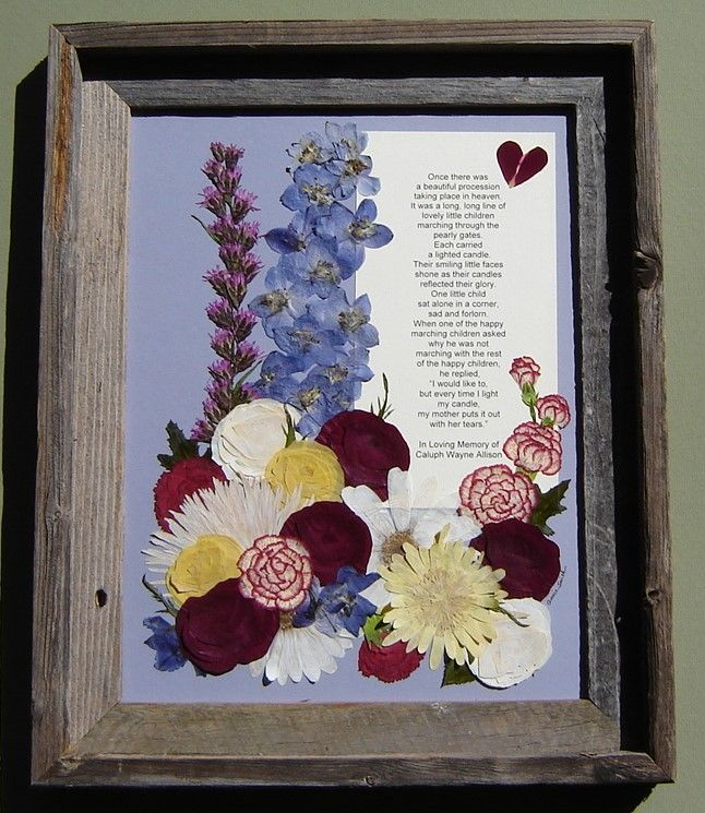 Memorial made from flowers gathered at a funeral for a little boy.  Flowers are pressed and arranged around a poem. Pressed Garden www.pressedgarden.com