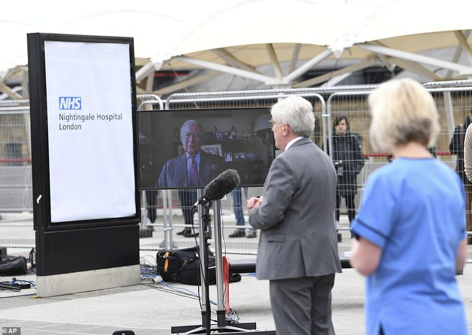 Prince charles is projected on a screen as he pauses prior