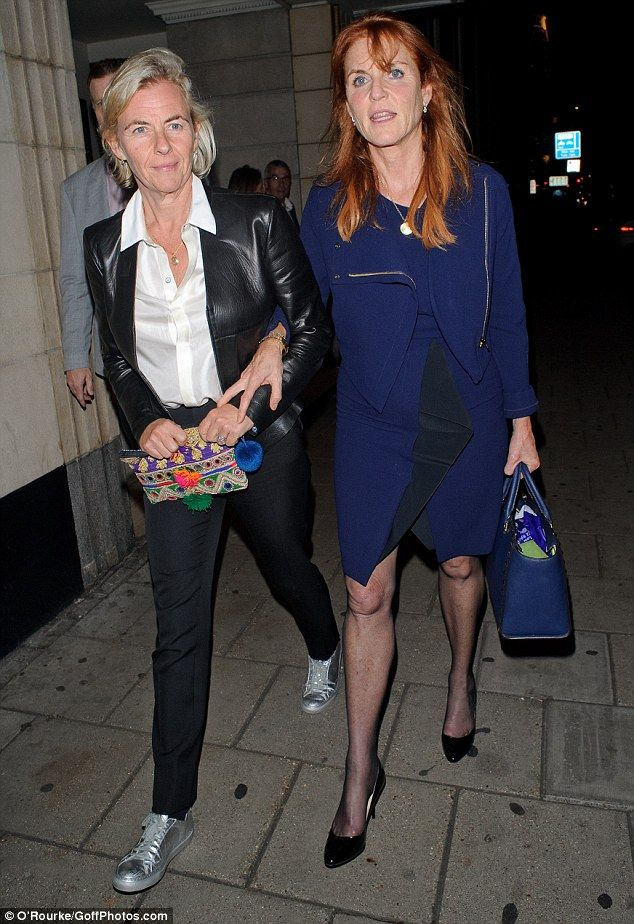 9/23/16*Sarah Ferguson looked elegant in a midnight blue jacket which complimented her matching handbag