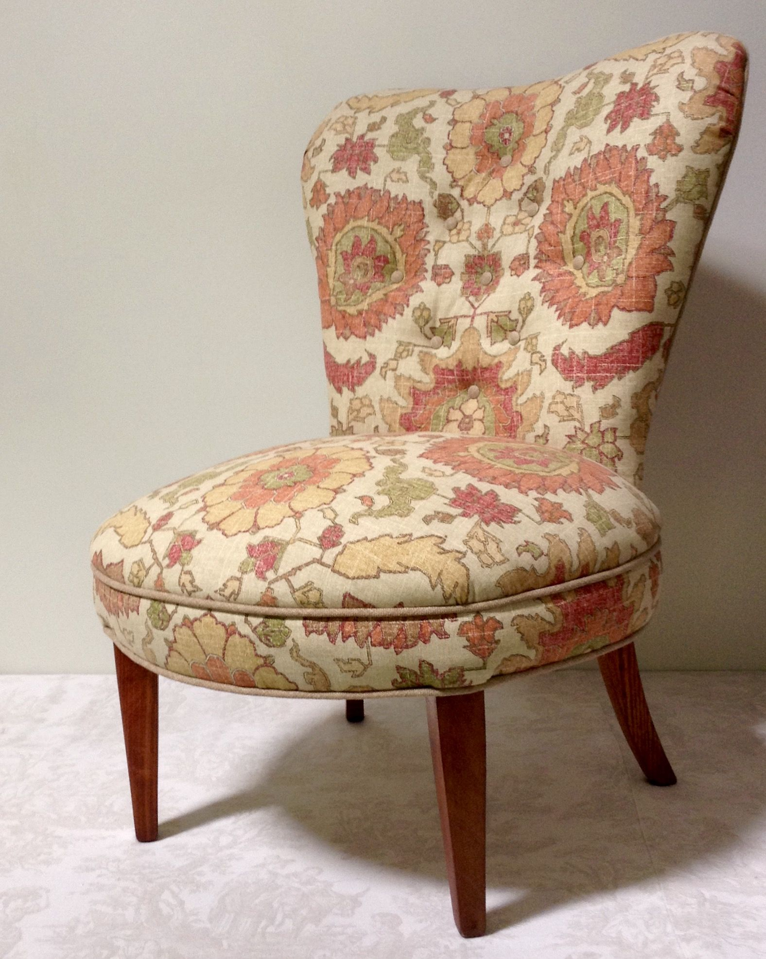 One of a kind. This chair's frame was hand made by a hobbyist way back when. It had Spanish Moss and wood shavings for padding!