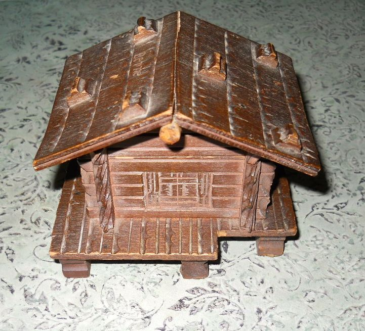 A wooden Swiss chalet  cabin inkwell. When the hinged roof is lifted that is where one would find the ink._Judith Walker's Collection