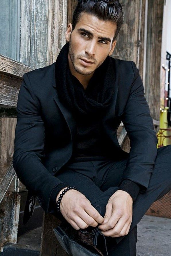 The handsome Richie Nuzzolese looks sharp in a slim cut black suit, black scarf, and black bead bracelet.  Monochromatic definitely works!