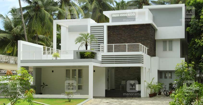 The Box Style Elevation And The Serene White Hue That Dons The Exteriors And Interior Kerala House Design Contemporary House Plans Contemporary House Exterior