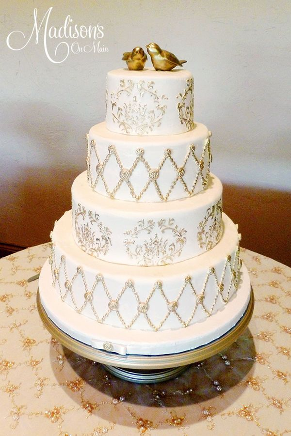 Gorgeous Cream And Gold Wedding Cake With Gold Birds Cake Topper